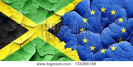 Jamaica flag with european union flag on a grunge cracked wall
