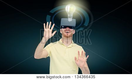 3d technology, virtual reality, cyberspace, entertainment and people concept - happy young man with virtual reality headset or 3d glasses playing game and looking at ligh bulb over black background