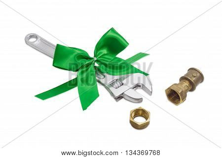 Adjustable wrench with green ribbon and some plumbing components on a light background