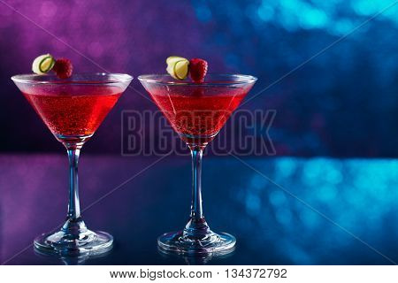 Two glasses of cosmopolitan cocktail on bar counter