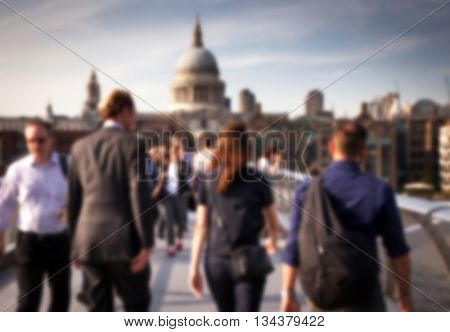 Blurred background of crowd of people on millennium bridge and st pauls cathedral in background, london