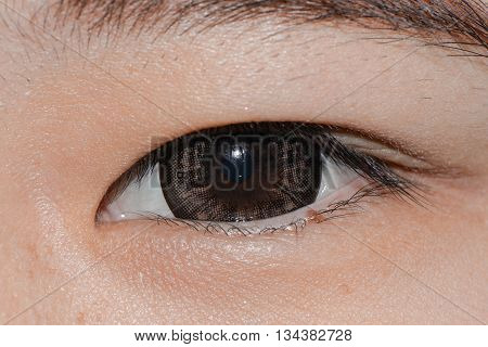 Close up - Woman eye with contact lens