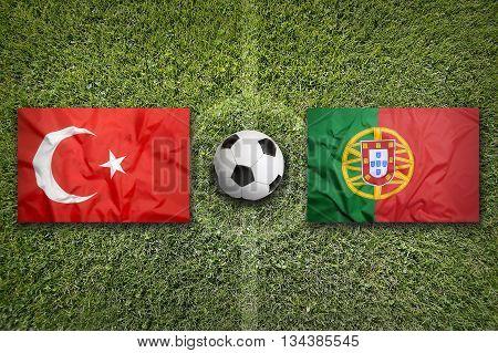 Turkey Vs. Portugal Flags On Soccer Field