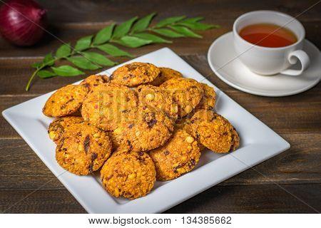 Sri Lankan parippu wade with plain tea