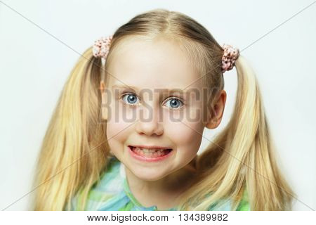 Smiling child with white hair - cute face portrait