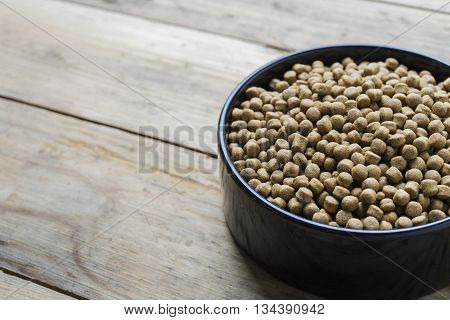 close up of dog food on wood table