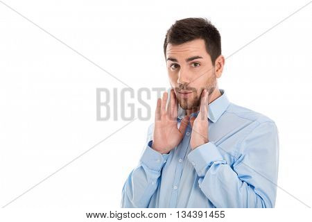 Isolated portrait of a business man wearing blue shirt with surprised and shocked expression.
