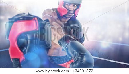 Rear view of boxer standing against boxing ring illuminated