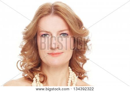 Portrait of beautiful healthy happy smiling mature woman with curly hair and clean make-up over white background