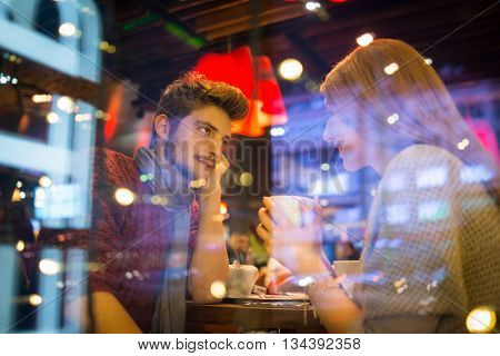 Romantic couple in city at night