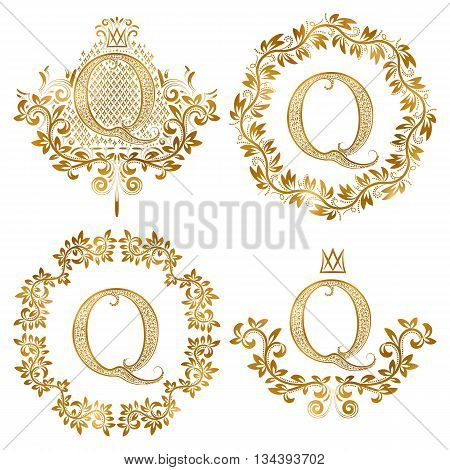 Golden Q letter vintage monograms set. Heraldic coats of arms and round frames.