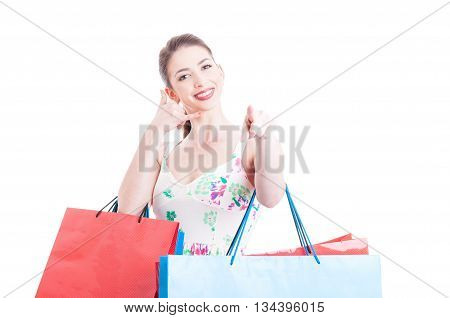 Beautiful Lady Shopper Making Call Me Gesture And Pointing