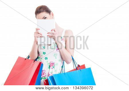 Woman At Shopping Hiding Over A Tablet