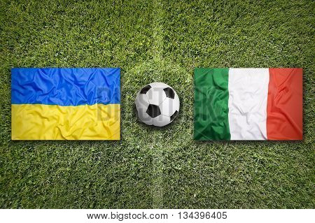 Ukraine Vs. Italia Flags On Soccer Field