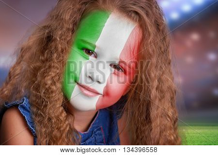 Soccer fan little smiling girl portrait with flag of Italy on face