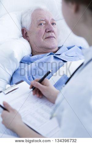 Nurse Interviewing Elderly Patient
