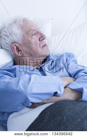 Elderly Patient Lying In Hospital Bed