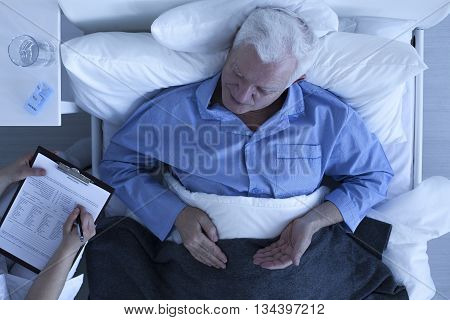 Doctor Taking Notes From Patient