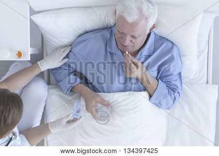 Patient Taking Pill With Glass Of Water