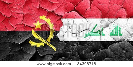 Angola flag with Iraq flag on a grunge cracked wall