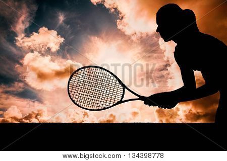 Tennis player playing tennis with a racket against dark sky with white clouds