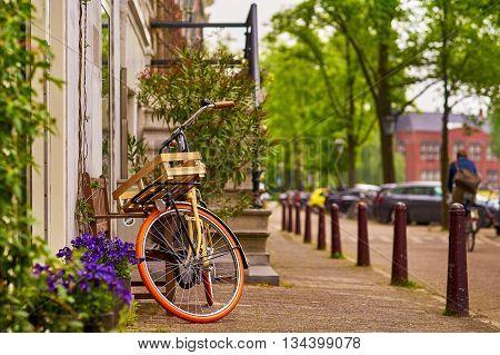 Vintage Bike on Street. Amsterdam Main Transportation System.
