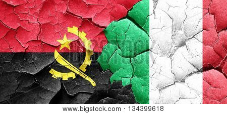 Angola flag with Italy flag on a grunge cracked wall