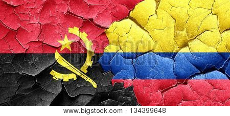 Angola flag with Colombia flag on a grunge cracked wall