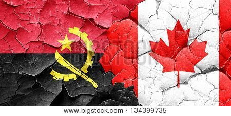 Angola flag with Canada flag on a grunge cracked wall