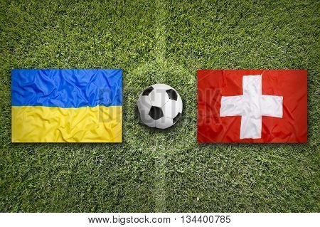 Ukraine Vs. Switzerland Flags On Soccer Field