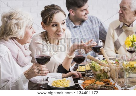 People enjoying traditional family mealtime at the table