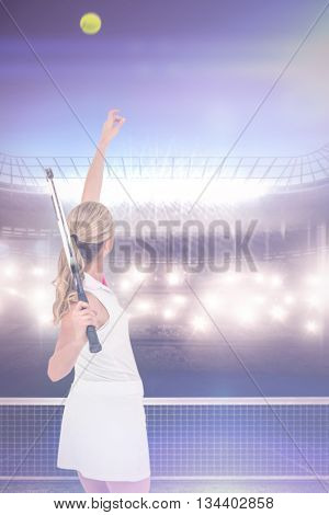 Athlete holding a tennis racquet ready to serve against digitally generated image of tennis court and spotlight