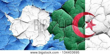 antarctica flag with Algeria flag on a grunge cracked wall