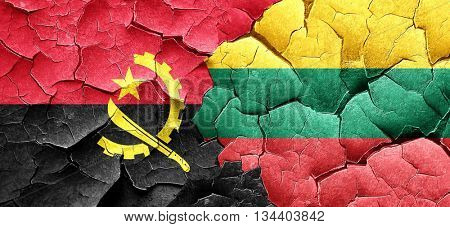 Angola flag with Lithuania flag on a grunge cracked wall