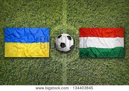 Ukraine Vs. Hungary Flags On Soccer Field