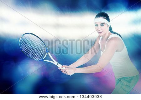 Female athlete playing tennis against digitally generated image of spotlight against black background