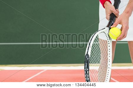 Athlete holding a tennis racquet ready to serve against digitally generated image of playing field