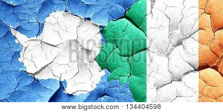 antarctica flag with Ireland flag on a grunge cracked wall
