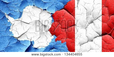 antarctica flag with Peru flag on a grunge cracked wall