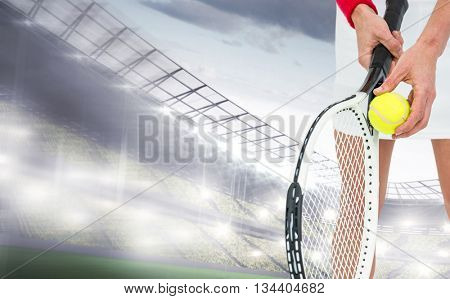 Athlete holding a tennis racquet ready to serve against sports arena