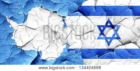 antarctica flag with Israel flag on a grunge cracked wall