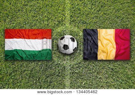 Hungary Vs. Belgium Flags On Soccer Field
