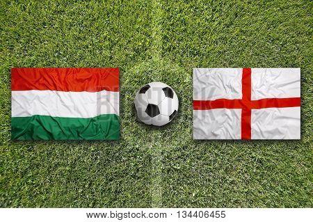 Hungary Vs. England Flags On Soccer Field