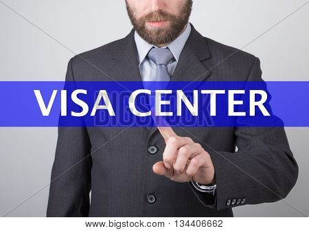 technology, internet and networking concept - Businessman presses visa center button on virtual screens. Internet technologies in business.