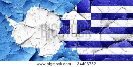 antarctica flag with Greece flag on a grunge cracked wall