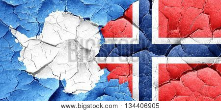 antarctica flag with Norway flag on a grunge cracked wall