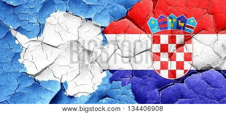 antarctica flag with Croatia flag on a grunge cracked wall