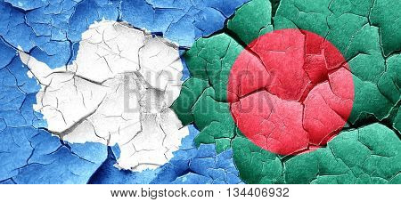 antarctica flag with Bangladesh flag on a grunge cracked wall