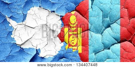 antarctica flag with Mongolia flag on a grunge cracked wall