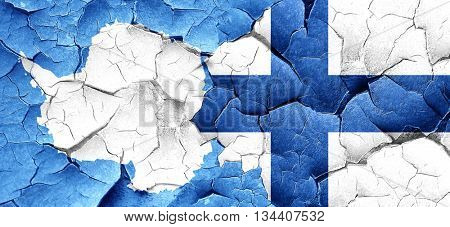 antarctica flag with Finland flag on a grunge cracked wall